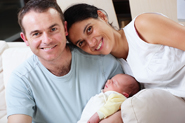 Happy couple with newborn baby
